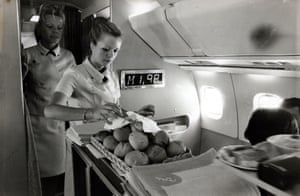 Hostesses serve fresh bread to passengers