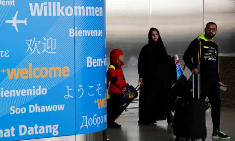 People exit immigration after arriving from Dubai at John F Kennedy international airport in New York.