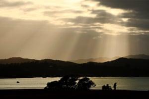 The sun breaks through the clouds at Waitangi.
