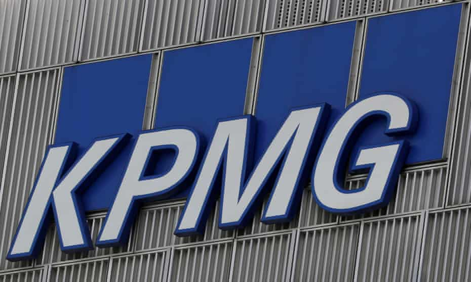 The KPMG logo on an office building in Canary Wharf, London