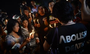 A group of Christians hold a candlelight vigil at Cilacap port.