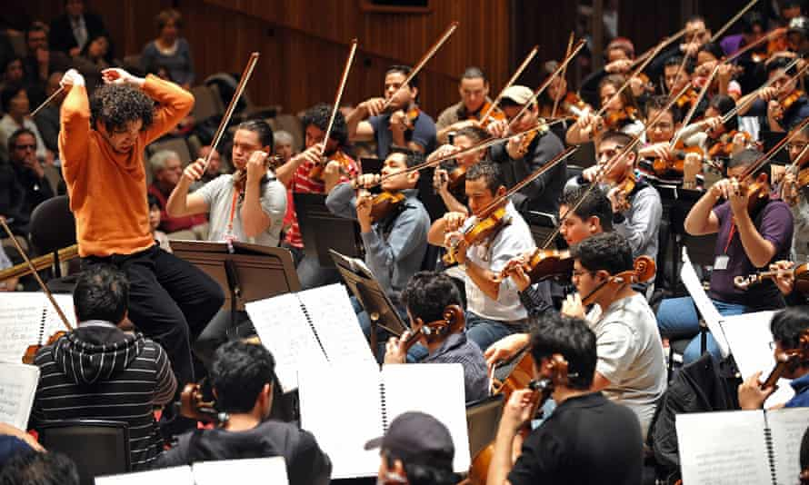 Dudamel rehearses with the Simón Bolívar Youth Orchestra in 2009. Photograph: Leon Neal/AFP/Getty Images