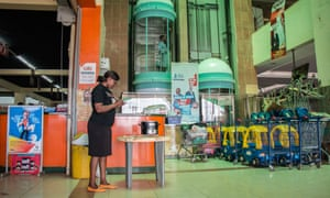Woman sells Burn stoves in Kenyan shopping centre