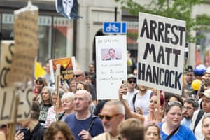 Anti-Hancock placards being waved by protesters in London yesterday attending an anti-lockdown 'freedom march'.