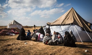 Women and children at a civilian screening point for suspected Isis families near the front line in Syria.
