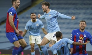 Manchester City's John Stones, centre, celebrates after scoring.