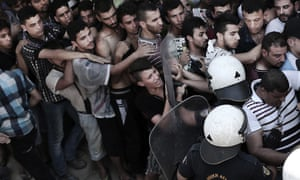 Police push back refugees  in Kos, Greece, in 2015