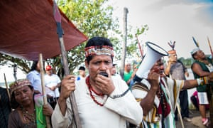 James Chuquival, from the San Jose de Saramuro indigenous community, protesting along the River Maranon in northern Peru.