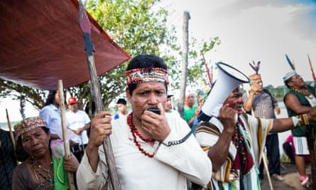 James Chuquival, from the San Jose de Saramuro indigenous community, protesting along the River Maranon in northern Peru.