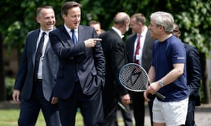 John Bercow in shorts and T-shirt jokes with David Cameron and aides in suits.