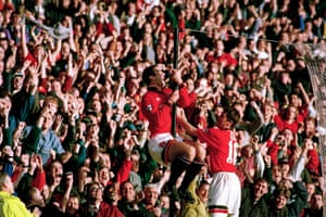Eric Cantona celebrates scoring on his comeback.