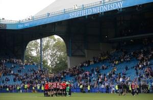 Sheffield United players huddle.