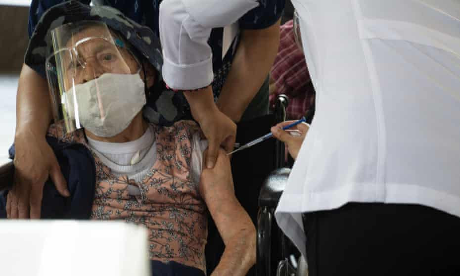 A elderly person being vaccinated in Mexico City