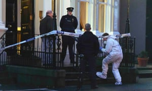 Police and forensic officers attend the scene of the shooting at the Regency Hotel in Dublin in February