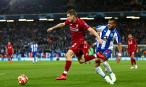 James Milner fends off Porto's Fernando Andrade during the Champions League quarter-final, first leg at Anfield.