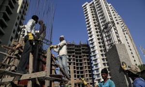 Construction workers on a building site in Mumbai, India