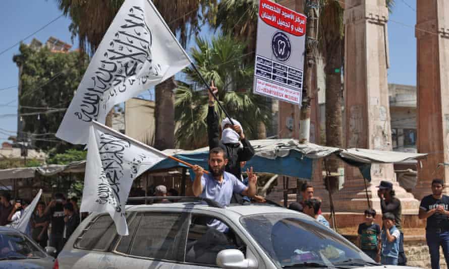 Hayat Tahrir al-Sham members waving flags