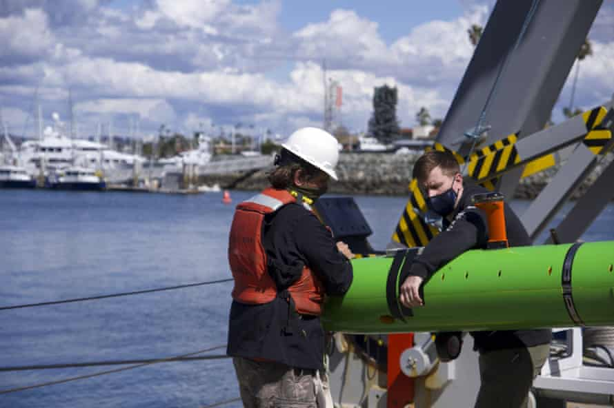 Researchers aboard the Sally Ride recover an autonomous underwater vehicle after a search for discarded barrels near Santa Catalina Island, California.