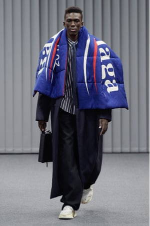 A model on the Balenciaga catwalk wearing a scarf with a logo inspired by Bernie Sander's presidential campaign.