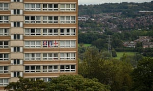 Flags on display in a residential tower block, Stoke-on–Trent.