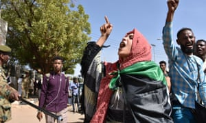 People outside the Sudanese foreign ministry in Khartoum protest over the allegedly deceitful treatment of relatives recruited to work in Libya