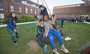 Children from Wren Mews playing in the garden at Baylis Old School development they were previously barred from using.