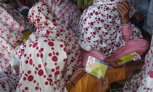 Women read safe abortion manuals, translated in Urdu by Aware Girls, at a community meeting in Swabi in northwest Pakistan.