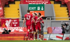 Liverpool's Trent Alexander-Arnold (right) celebrates with teammates after scoring the late winner.