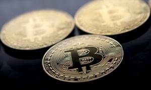 Gold plated souvenir Bitcoin coins arranged for a photograph in London.