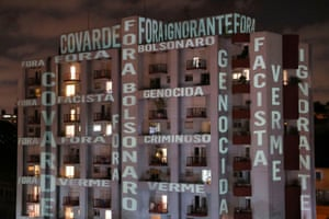 Slogans denouncing Jair Bolsonaro's response to the pandemic are projected on a building in São Paulo in Brazil