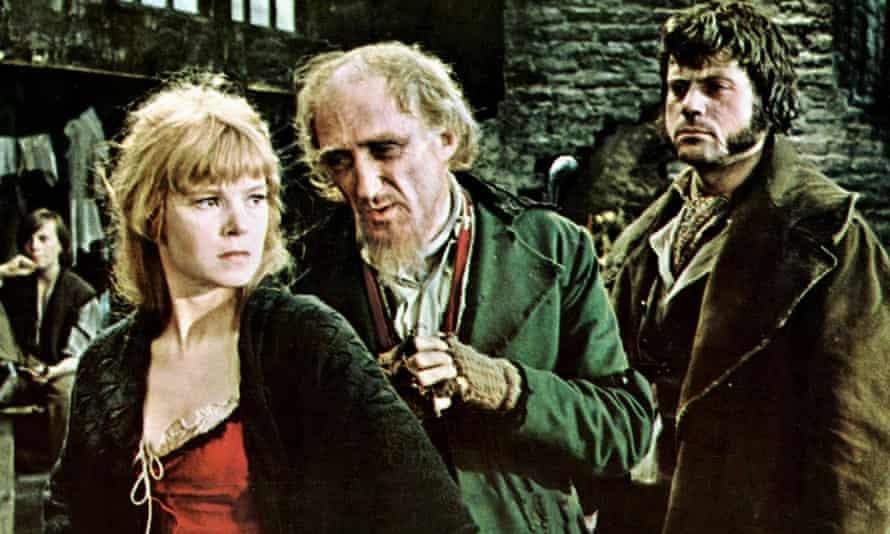 Nancy as portrayed by Shani Wallace, with Ron Moody as Fagin and Oliver Reed as Bill Sikes in the film Oliver! from 1968.