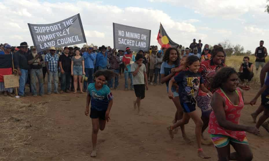 Children run in front of the re-enactment of the Noonkanbah march