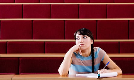 Female student in lecture hall.