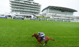 Derby winner Serpentine finishes all on his own in front of the deserted stands at Epsom.