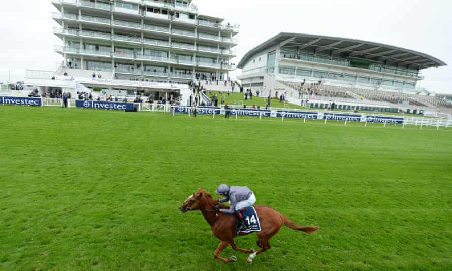 Serpentine comes home alone in the Derby in front of the deserted stands at Epsom.