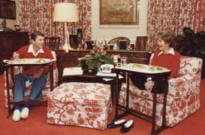 Peach florals … President Ronald Reagan and his wife Nancy eat TV dinners in their White House quarters in 1981.