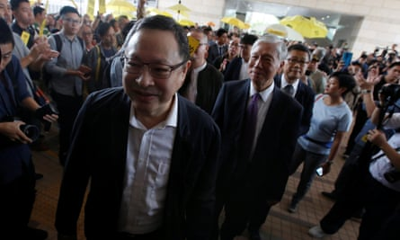 Occupy Central pro-democracy movement founders Benny Tai, Chu Yiu-ming and Chan Kin-man walk into court.