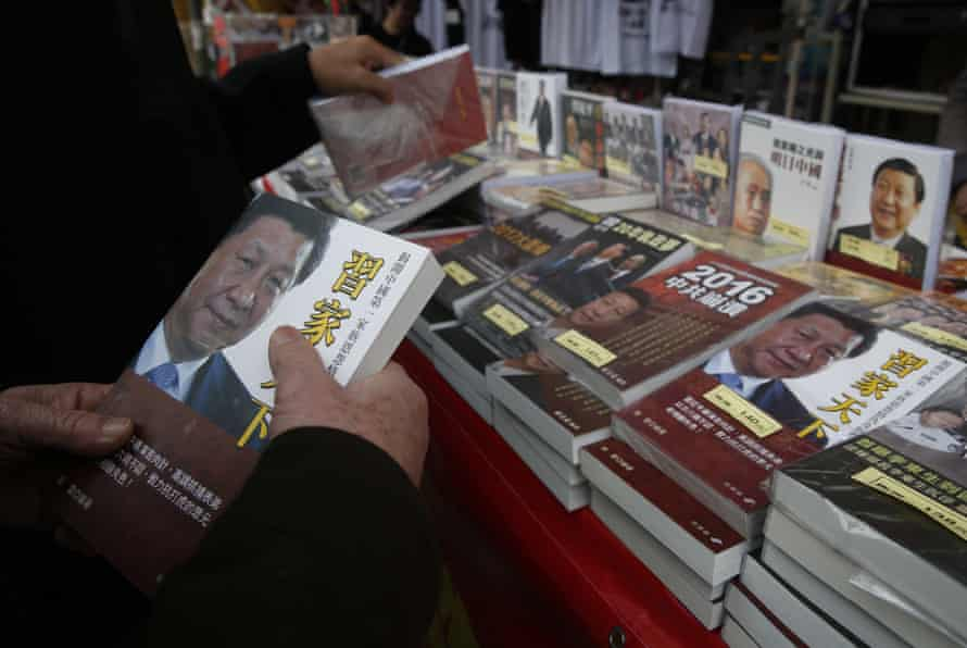 Deemed harmful … books banned on the Chinese mainland on sale in a Hong Kong market last February. Many such titles have now been withdrawn.