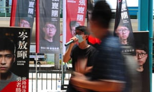 A candidate campaigns during Hong Kong pro-democracy opposition primaries