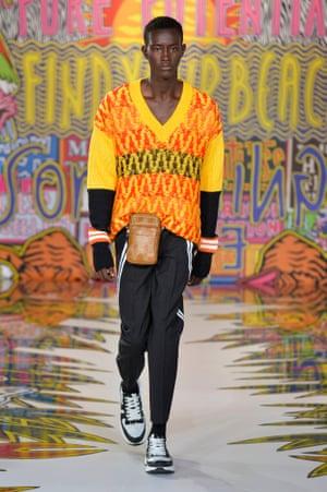 A model wearing colourful knitwear by Neil Barrett