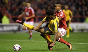 Arsenal's Chuba Akpom is brought down in the area by Nottingham Forest's Michael Mancienne resulting in a penalty which Lucas Perez converted to double the Gunners' lead.