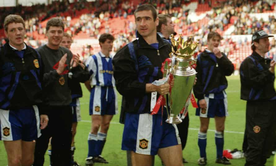 Eric Cantona and his Manchester United team-mates celebrate with the Premier League trophy in 1996.