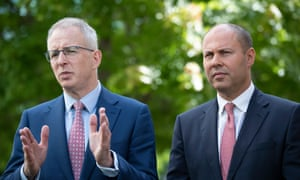 Communications minister Paul Fletcher and treasurer Josh Frydenberg speak to the media after reaching a deal with Facebook on the news code
