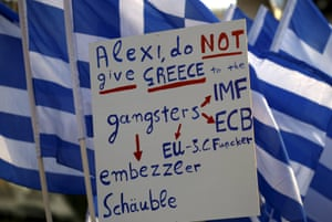 Protesters hold a banner in front of the parliament during a pro-government rally calling on Greece's European and International Monetary creditors to soften their stance in the cash-for-reforms talks in Athens, June 17, 2015. The Greek central bank warned on Wednesday that the country risked a painful exit from the euro and ultimately even the European Union if Athens and its creditors do not strike a swift aid-for-reforms deal. REUTERS/Yannis Behrakis