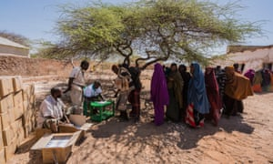 Villagers at a World Food Program aid centre on the outskirts of Mogadishu, Somalia. Many of these people will have walked for days from rural villages looking for food in the nation's capital after severe drought hit crops and  livestock, March 2017