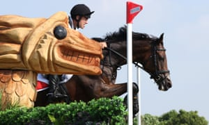 Switzerland's Felix Vogg, riding Colero, clears a jump during the eventing cross-country team and individual.