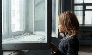 girl standing near window