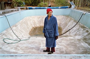 A man in an empty swimming pool