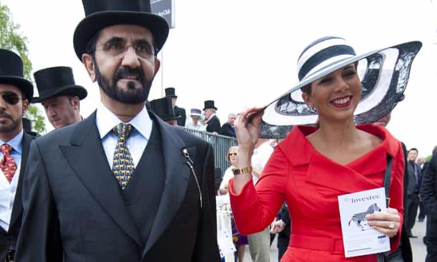 Princess Haya bint Al-Hussein and Sheikh Mohammed bin Rashid al-Maktoum arrive for the Epsom Derby Day at Epsom Downs in June 2013.
