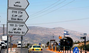 Israeli security forces guard a bus station at the Tapuach junction near the West Bank city of Nablus